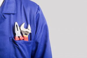 HVAC-technician-blue-shirt-tools-in-pocket