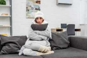 woman-wrapped-in-blanket-looking-cold